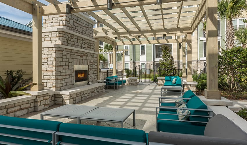 View of the outside lounge area near the fire pit at Integra River Run