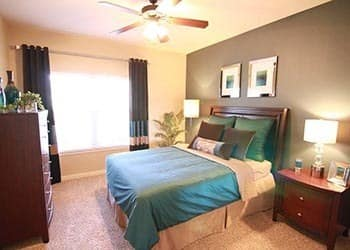 Bedroom at apartments in Overland Park, KS