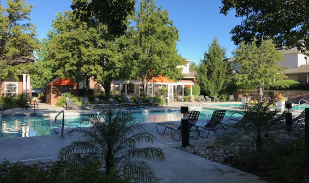 Nature around the pool at Lexington Farms Apartment Homes in Overland Park
