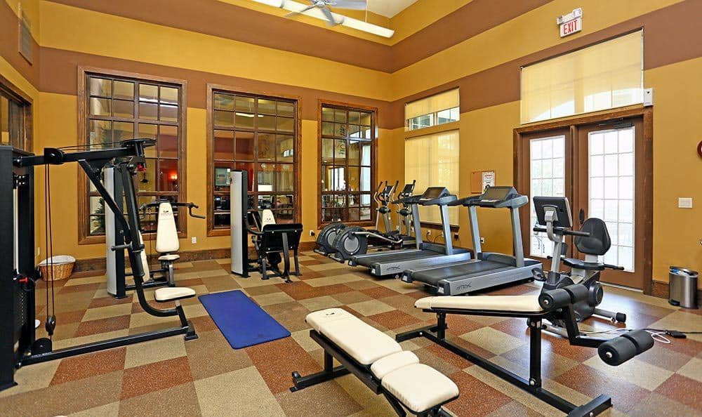 Fitness Center at Sorrento at Tuscan Lakes in League City, TXhttps://g5-assets-cld-res.cloudinary.com/image/upload/q_auto,f_auto,fl_lossy/g5/g5-c-1tcn5na6-jmg-realty/g5-cl-542sazo9q-sorrento-at-tuscan-lakes/uploads/master-bedroom-apartments-league-city.jpg