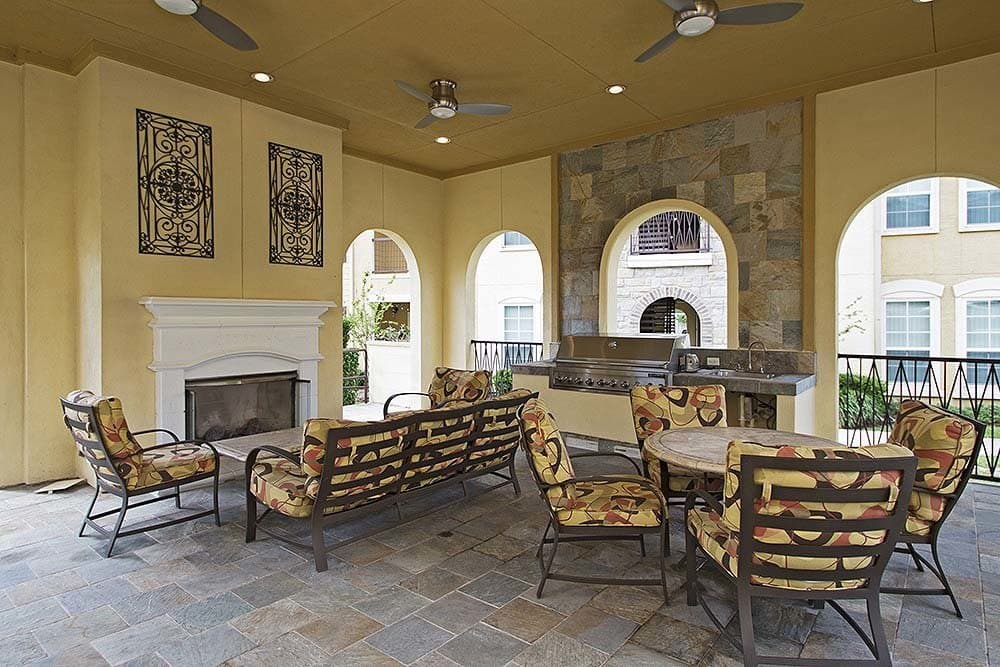 Outdoor patio with fireplace at Amalfi at Tuscan Lakes