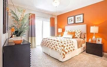 Model unit master bedroom at Elle at The Medical Center