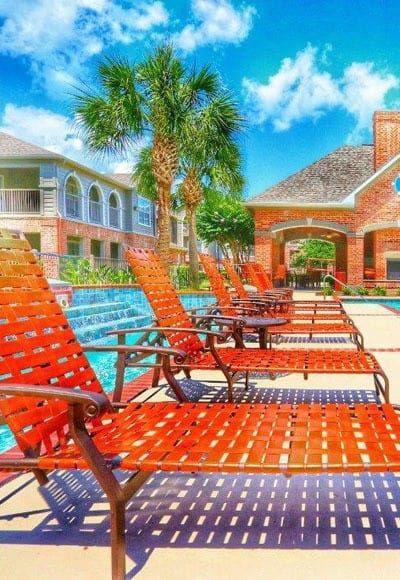 A chair by our sparkling swimming pool here at Southwind at Silverlake Apartments on a hot day is the place to be!