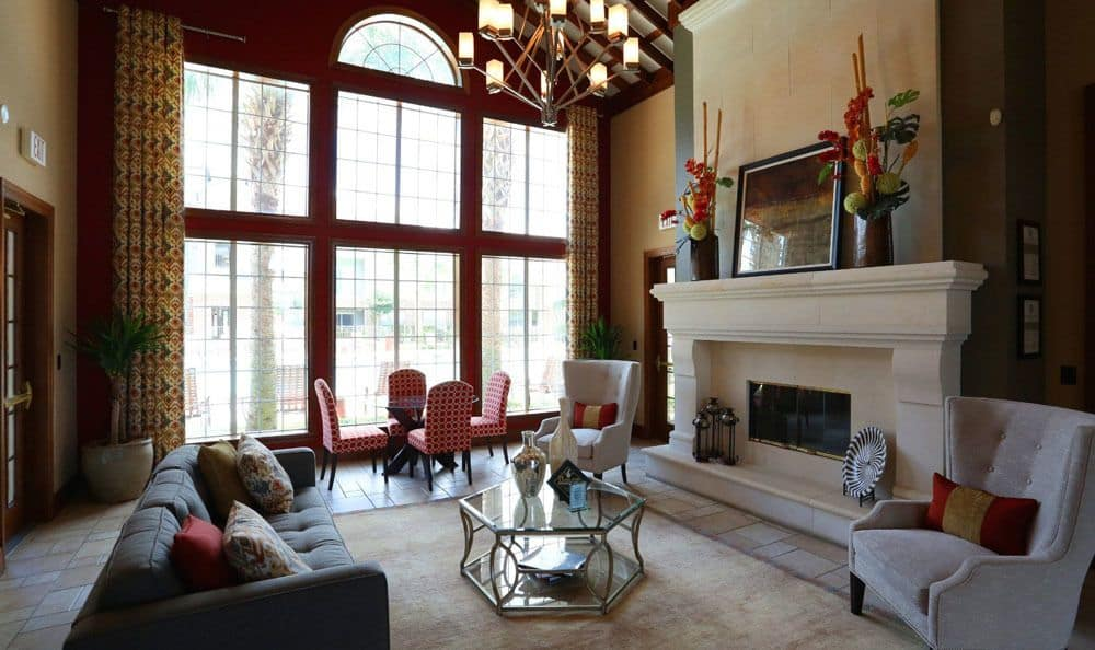 Indoor fireplace with stone molding at Southwind at Silverlake Apartments in Pearland, TX