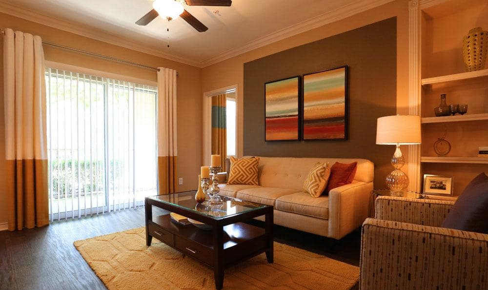 Apartment living room at Southwind at Silverlake Apartments in Pearland, TX