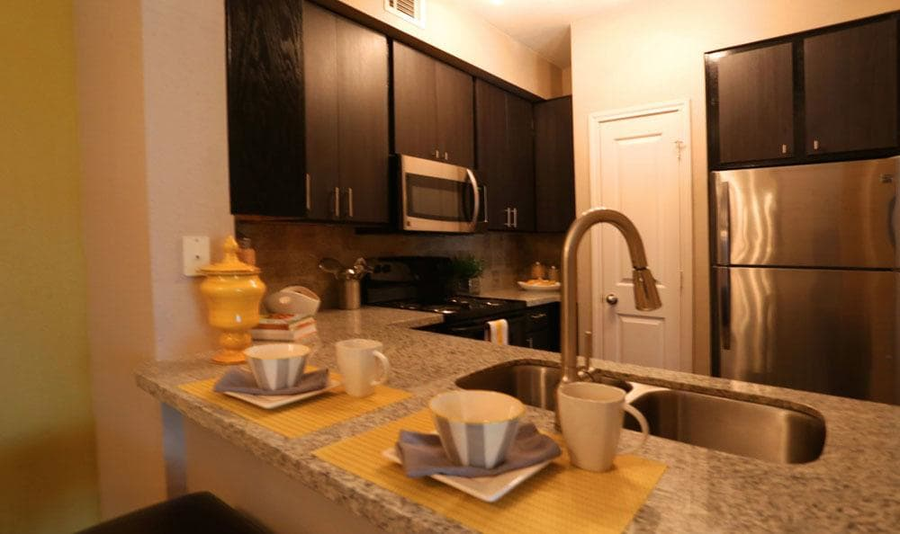 Apartment kitchen at Southwind at Silverlake Apartments in Pearland, TX