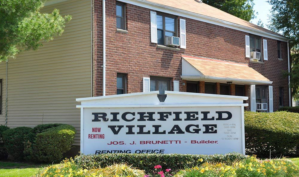 Monument sign at apartments for rent at Richfield Village Apartments in Clifton.