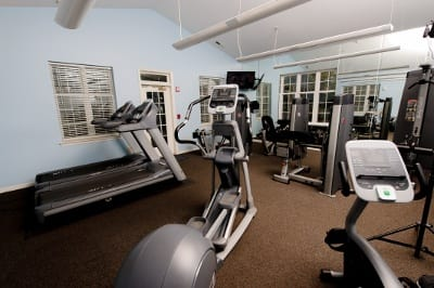 Fitness center at apartments for rent at Mill Pond Village Apartments.