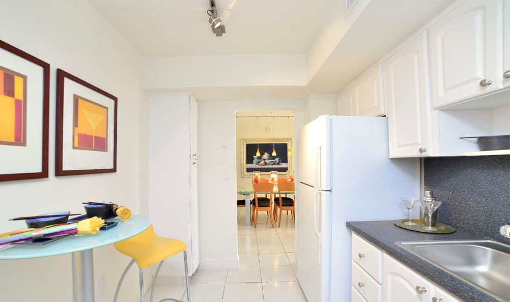 Kitchen to dining room at Marina del Mar in Sunny Isles Beach.