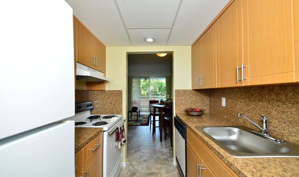 A view of the living room from the kitchen at Forest Place Apartments in North Miami.