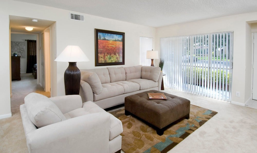 Furnished apartment living room at Azalea Village Apartments in West Palm Beach.