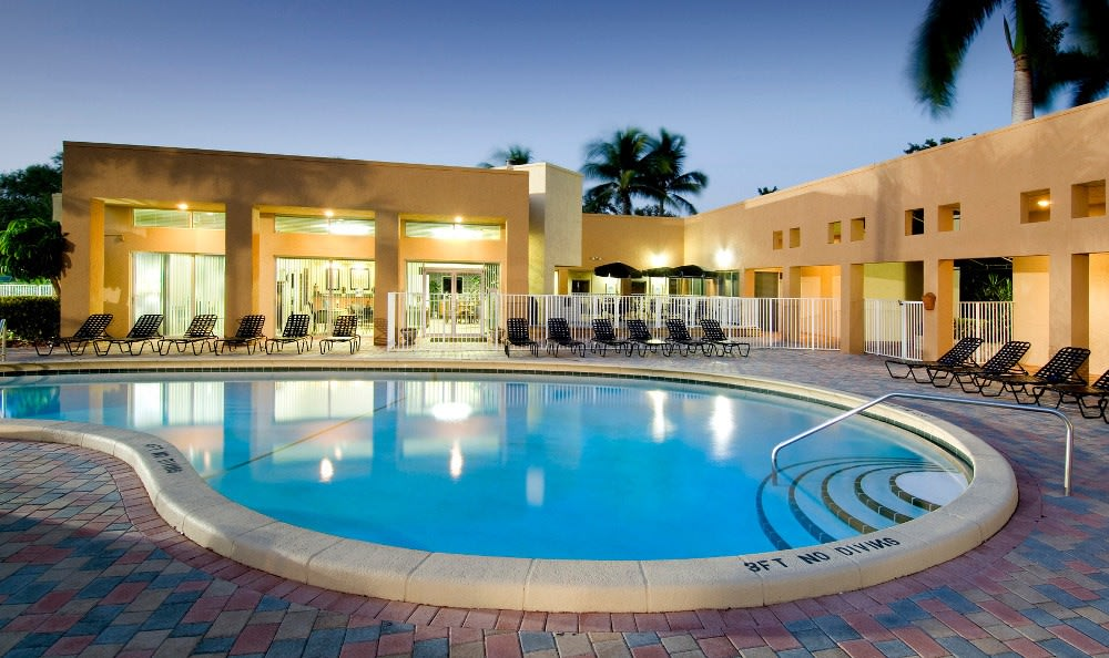 Pool at night at Azalea Village Apartments in West Palm Beach.