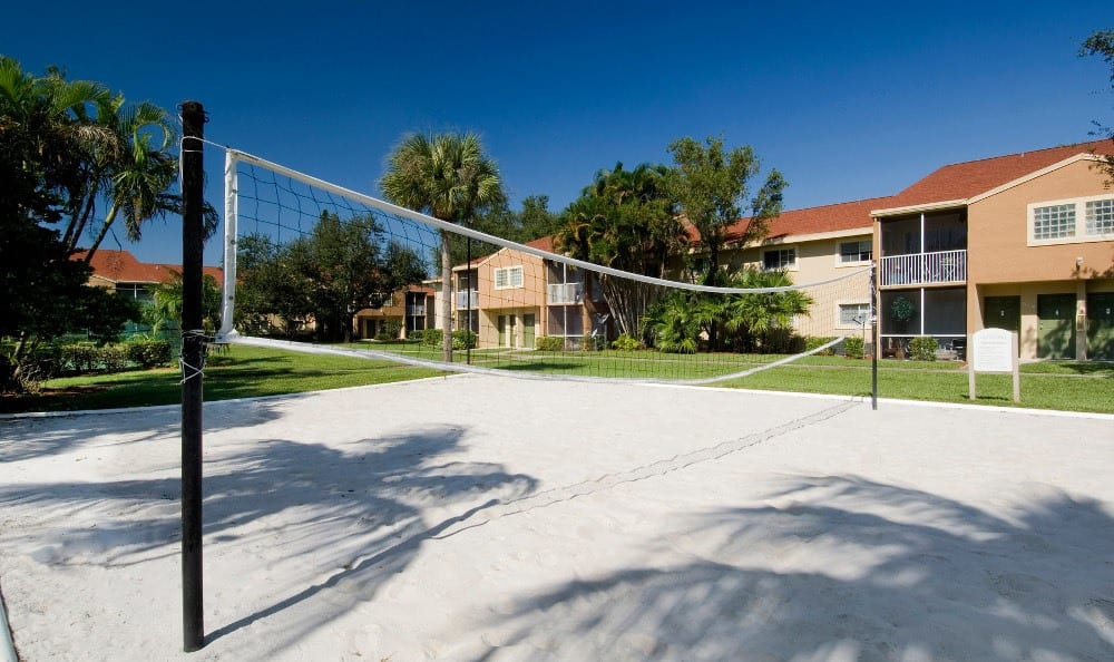 Volleyball courts at Azalea Village Apartments in West Palm Beach.