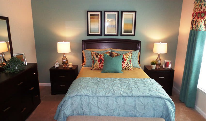 View of the master bedroom in one of our model apartment homes at The Vinings at Newnan Lakes