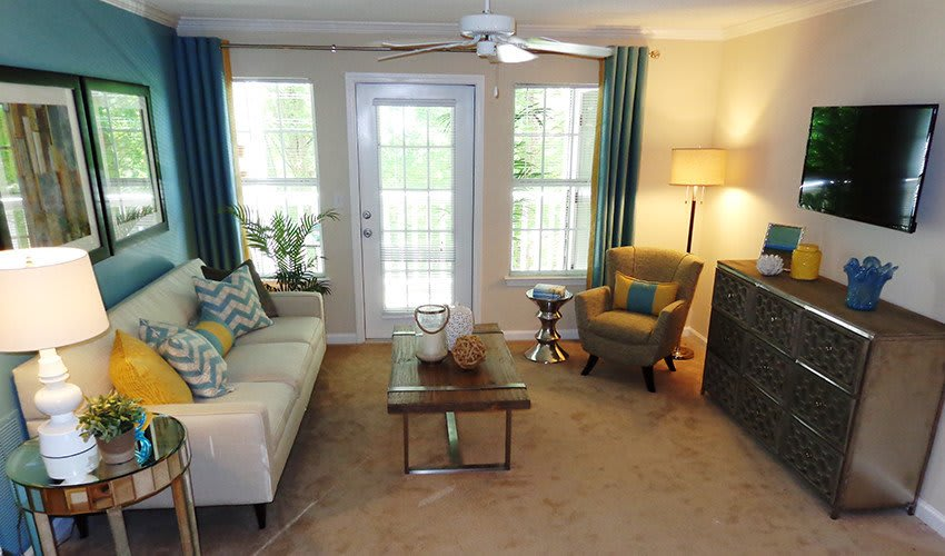 The spacious living rooms at The Vinings at Newnan Lakes apartments are a great place to relax at the end of a long day.