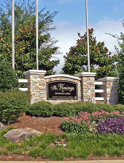 Our sign welcomes residents and their guests - and prospective residents - at our garden-style community in Newnan, GA