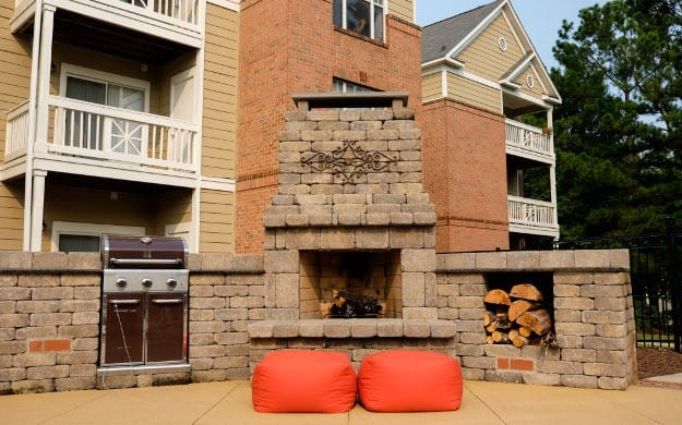 Our courtyard with a fireplace here at Mariners Crossing apartments