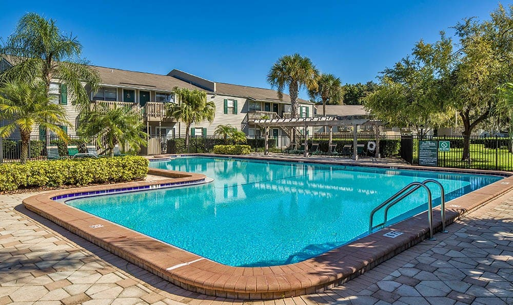 Sparkling pool at Countrywood Apartments in Tampa, FL