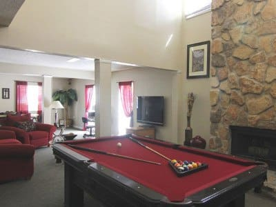 Play billiards at Creekwood Apartment Homes with friends