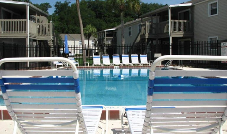 Seating at the pool at Creekwood Apartment Homes