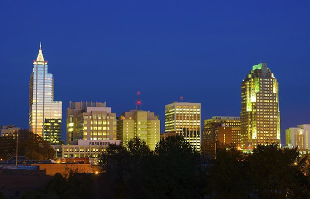 View of the Raleigh skyline at night.