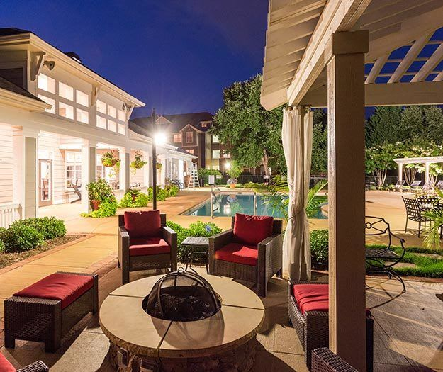 The firepit and outdoor barbecue and seating area in the evening at The Seasons at Umstead are not to be missed!