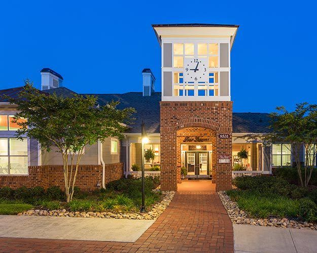 Evening view of the exterior of our leasing center at The Seasons at Umstead - where the journey to your better life begins!