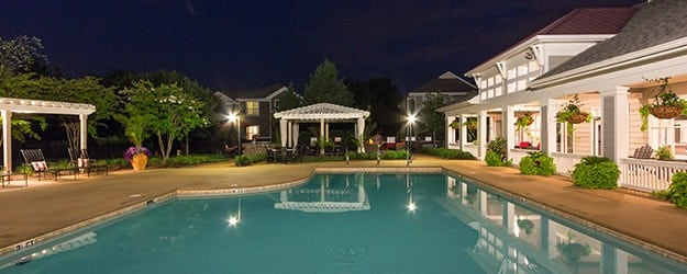 Enchanting evening view of the pool and clubhouse area at The Seasons at Umstead