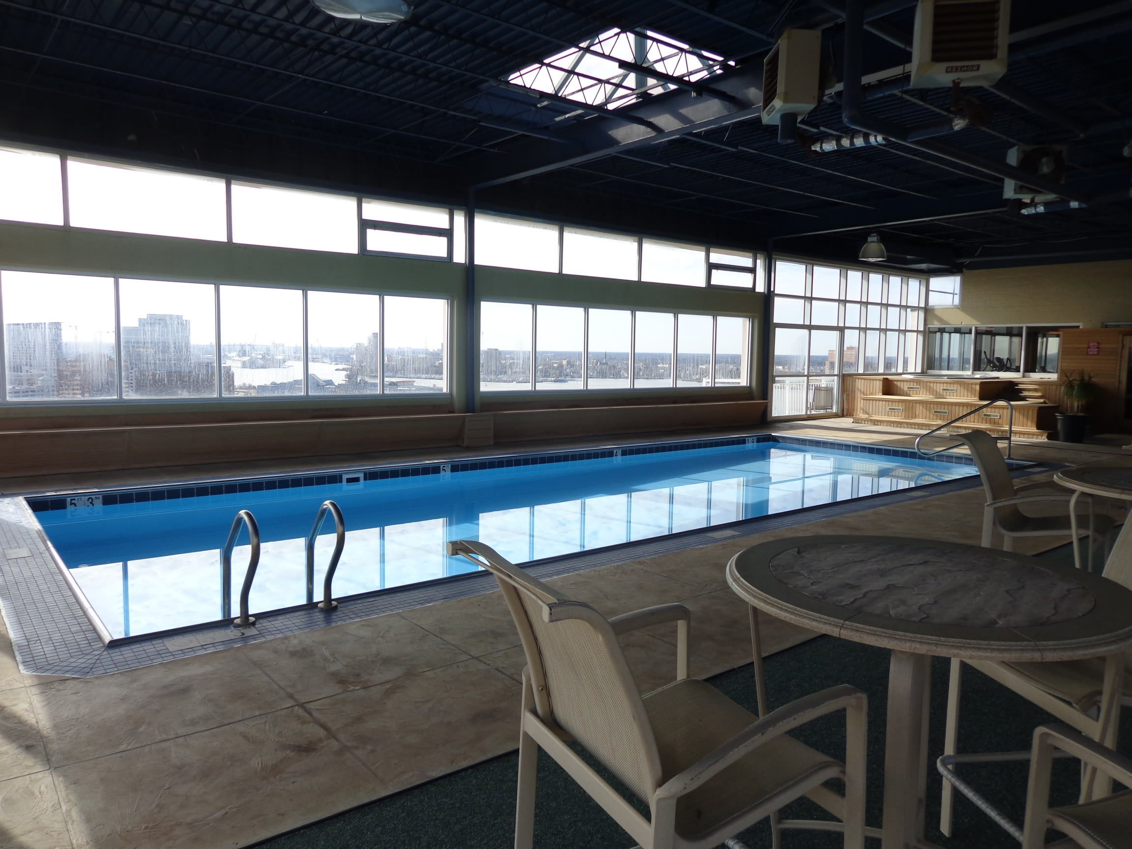 Indoor Swimming Pool with Seating at Hague Towers in Norfolk, Virginia