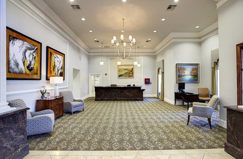 The spacious lobby at Conservatory At Plano is a great place to chat with your new friends and neighbors.