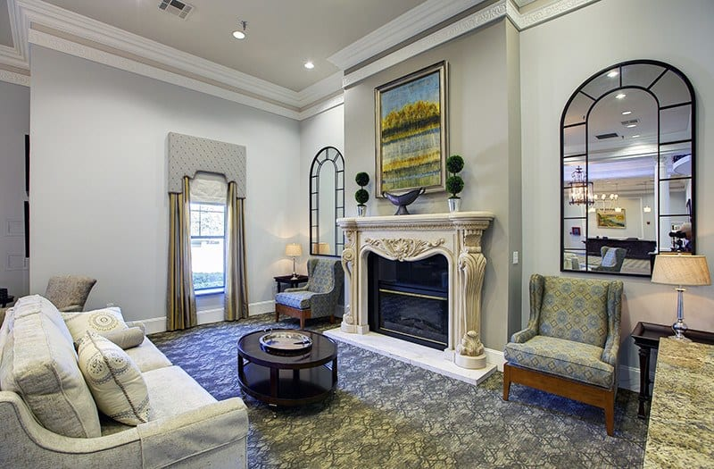 Our lounge has a marble fireplace, perfect for staying cozy and warm on chillier days here in Plano, TX.