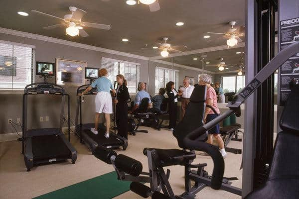 Fully equipped fitness center for The Woodlands senior living residents