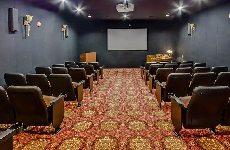 Come watch a movie with your new friends in our expansive theater room at Conservatory At Champion Forest.