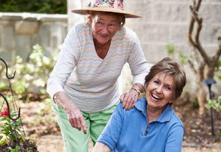 Senior living residents garden together for social health