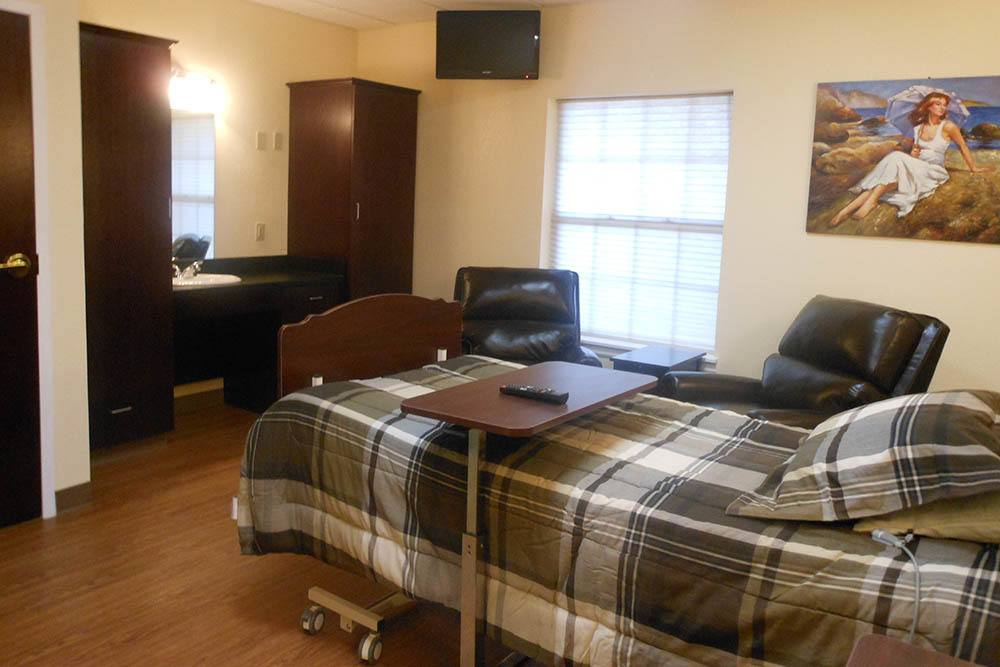 bedroom and chairs in Bartlesville
