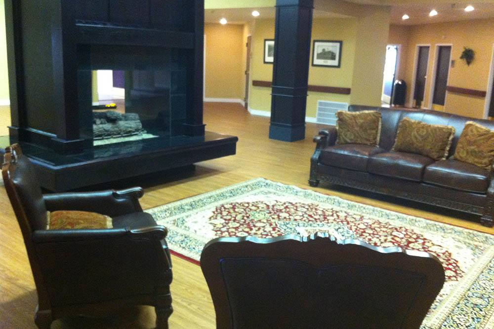Seating area with fireplace at Adams PARC Post Acute Recovery Center