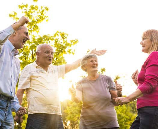 Residents enjoy an event outside hosted by Cottagewood Senior Communities