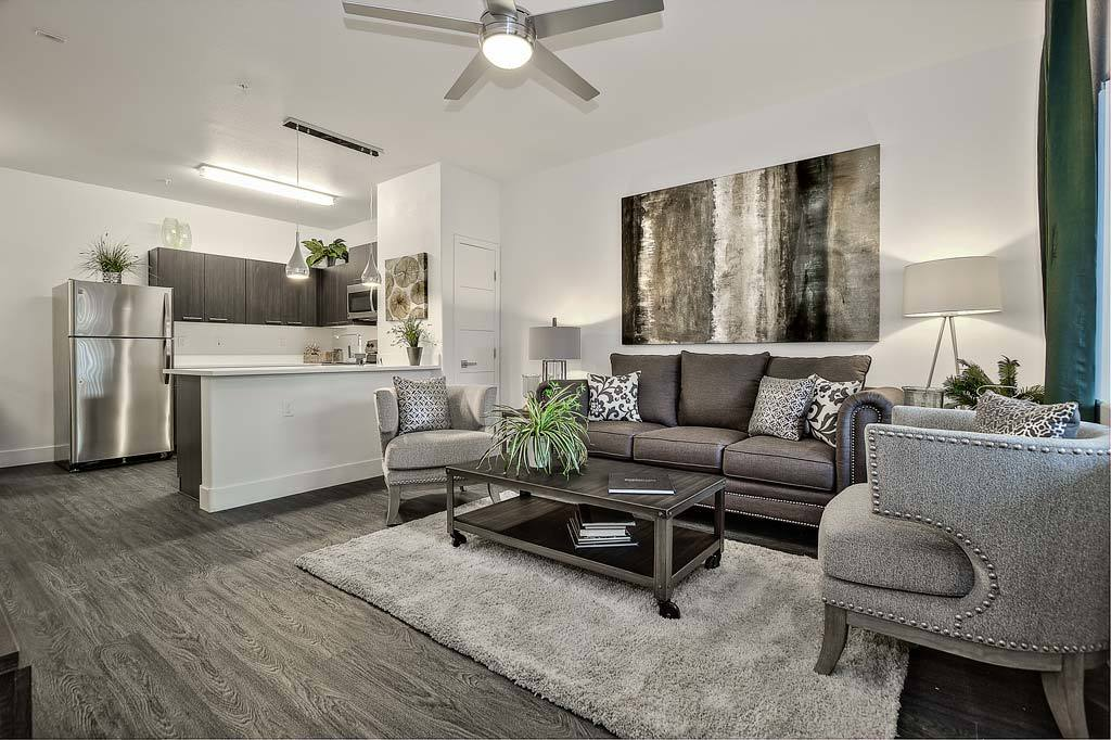 Well Decorated Living Room Looking Into Modern Kitchen At Union Apartments  Model Home In Las ...