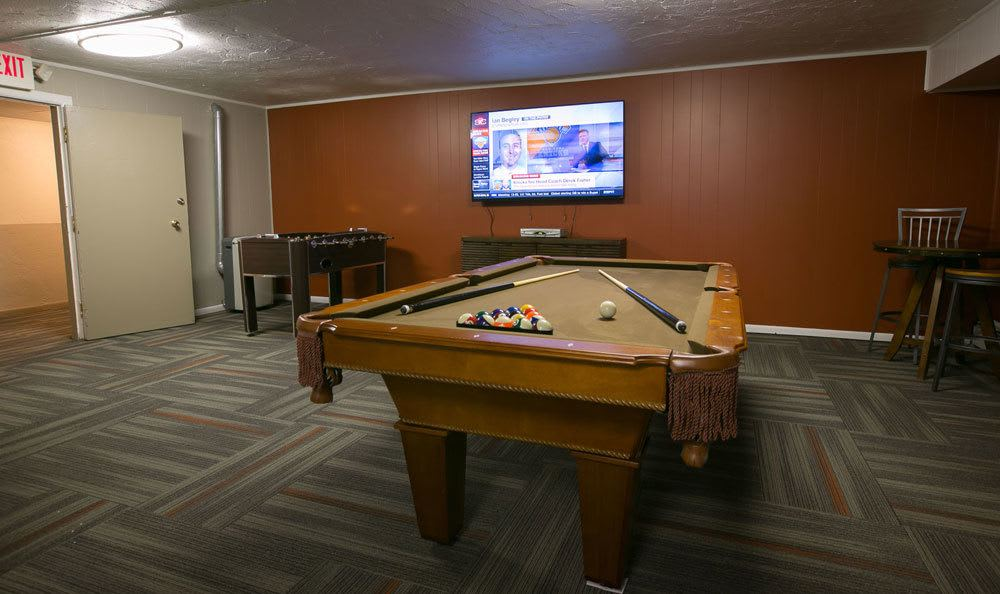 Pool table at apartments in Oakwood Village