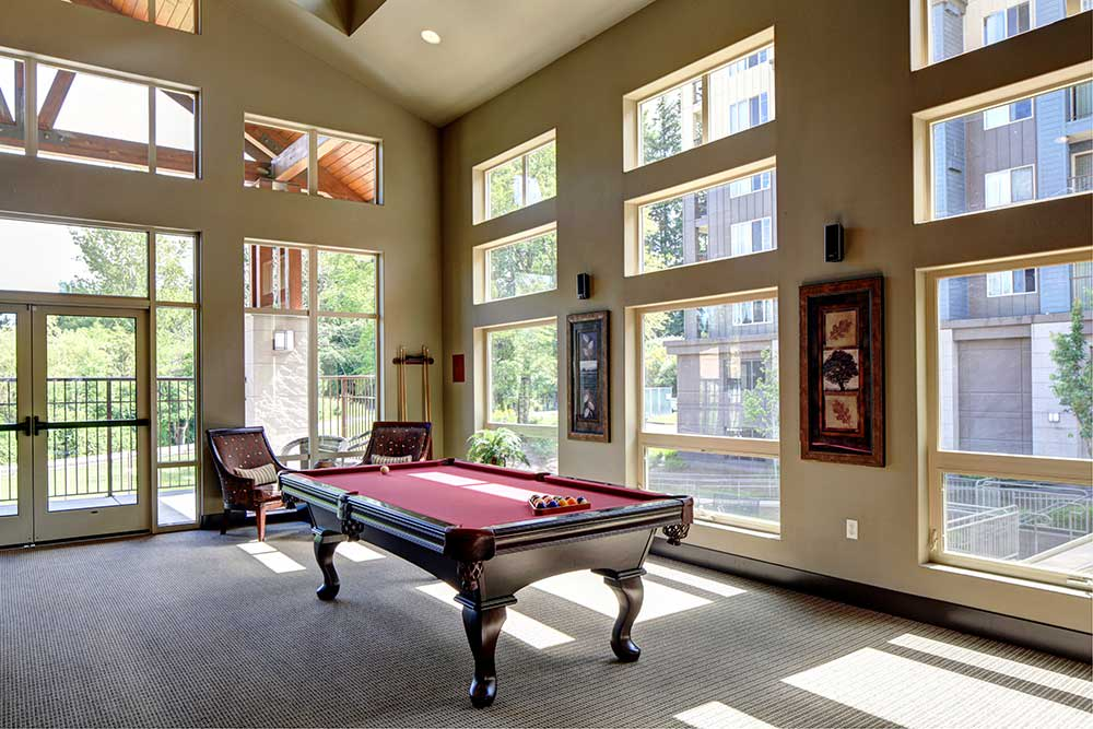 Well-lit pool table in the Echo Lake Apartments community room
