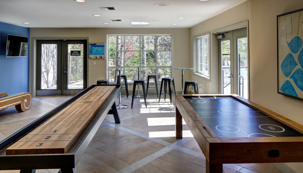 Enjoy the clubhouse with a game room at On The Green at Harbour Pointe apartment homes