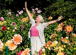 Resident enjoying the flowers at the senior living in Little Rock