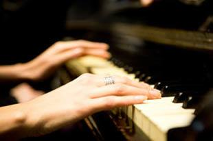 Learn to play piano at senior living in St. Petersburg