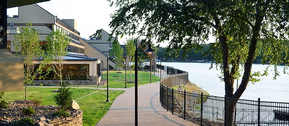 Hot Springs senior living features paths by the water.