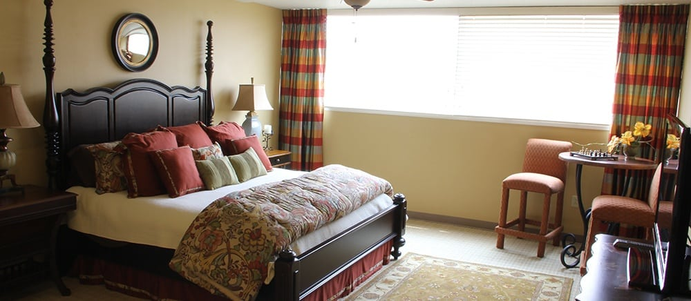 Elegant bedroom in Hot Springs senior living.