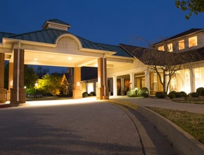 Senior living in Fayetteville entrance at night.