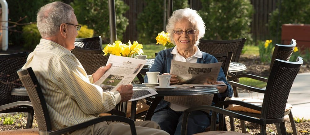 Resident laughing with caregiver at Tallahassee senior living.