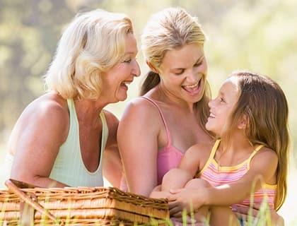 Three generations picnic at senior living in Tallahassee.