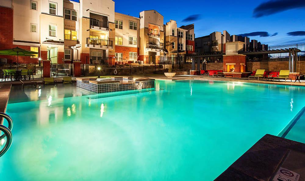 Pool at night At Harvest Station Apartments In Broomfield CO
