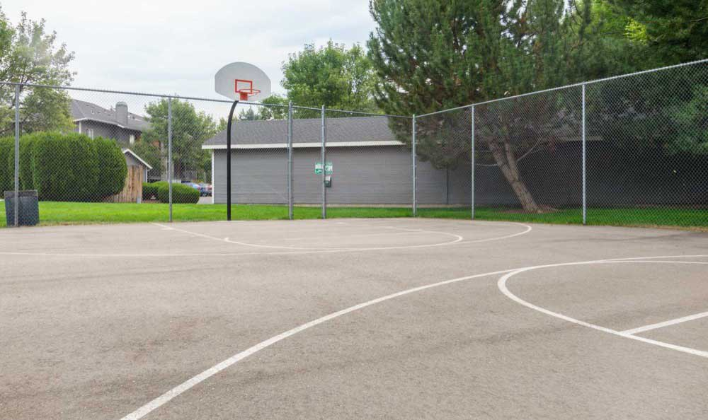 A basketball court is onsite for your enjoyment at Arbor Crossing Apartments